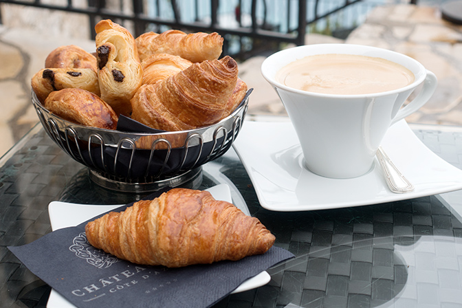 Enjoy coffee and croissants at the Chateau Eze with panoramic views of the Mediterranean